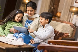 Children teaching mother